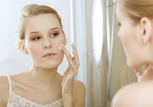 a woman applying an effective skincare beauty routine