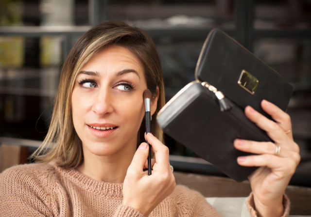 a woman applying her post-treatment makeup must haves from Beauty Affairs